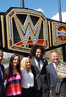Mayor Buddy Dyer unveils giant WrestleMania title belt at Lake Eola
