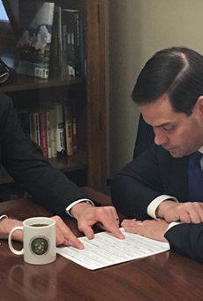 Please caption this photo of Marco Rubio and Rick Scott