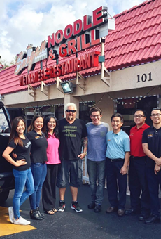 The Nguyen family, owners of Saigon Noodle & Grill, poses for a pic with Fieri after taping the show.