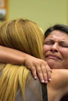 Jessica Realin hugs Pulse owner Barbara Poma.