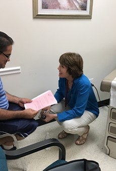 Gwen Graham takes a stand for uninsured at Longwood charitable clinic 'workday'