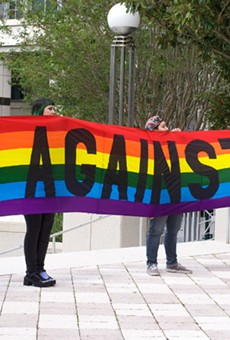 The group Gays Against Guns holds a rainbow banner outside the Orange County courthouse in support of the assault weapons ban.