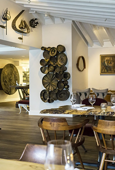 The dining room at 1921 by Norman Van Aken is full of eclectic art collected by the chef.
