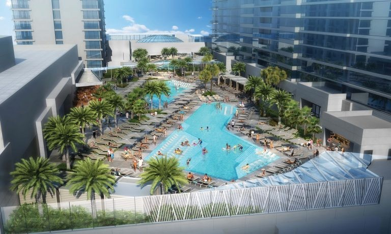 The new pool deck currently under construction at the Seminole Hard Rock Tampa. The current hotel tower can be seen in the upper left corner of the rendering with the new tower on the right side. - IMAGE VIA SEMINOLE HARD ROCK TAMPA