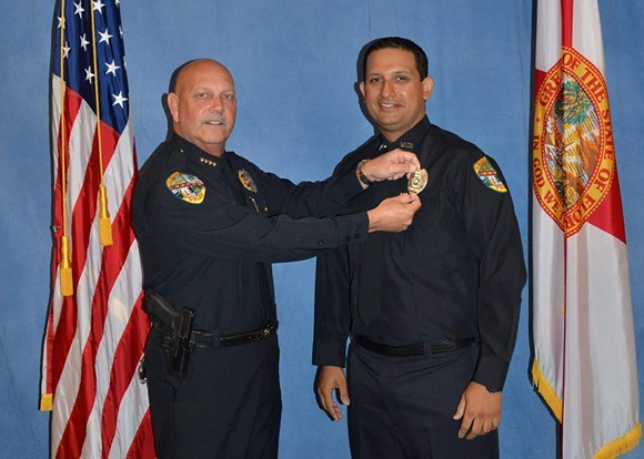 PHOTO OF OFFICER NOUMAN RAJA, RIGHT.