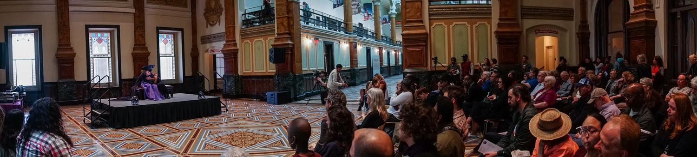 "Wanda Raimundi-Ortiz performs ""Pieta,"" a reinterpretation of Michelangelo's iconic masterpiece as a live performance set in the Smithsonian National Portrait Gallery - PHOTO VIA WANDA RAIMUNDI-ORTIZ"