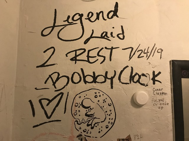 Bobby Clock memorial in the bathroom at Uncle Lou's - BAO LE-HUU