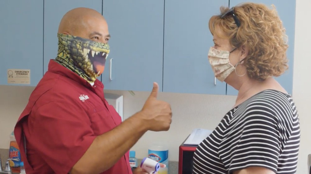 Gatorland's public safety preparedness video shows employee temperature checks - SCREENSHOT VIA GATORLAND/YOUTUBE