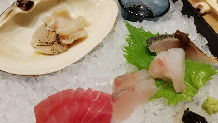 Sashimi (clockwise from top left): Aoyagi (orange clam), saba (Japanese mackerel), hata (Japanese grouper), baby kanpachi, aged bigeye tuna