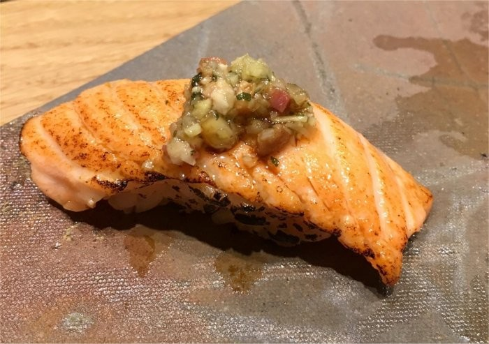 Nigiri of New Zealand king salmon with ginger and bacon