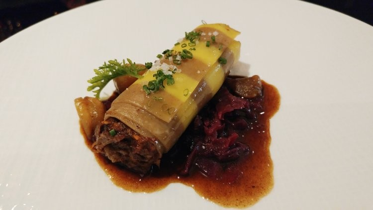 Braised jerked oxtail cannelloni, red wine reduction, mulled red cabbage, roasted chestnuts - FAIYAZ KARA