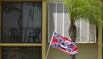 A Florida man with a Confederate flag on his van rammed into a black couple over a parking spot