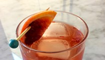 Our take on the Dubonnet Fizz fortifies the classic recipe with the punch of mezcal