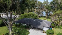 This lakefront home in East Orlando is on the market under $330K