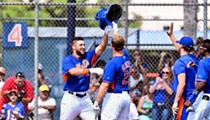Tim Tebow autographs ball after throwing it into man's testicles