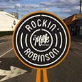Milk District sets up the barricades for Rockin' Robinson music fest this Saturday