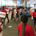 Orlando airport workers protest airlines for low wages amid record profits