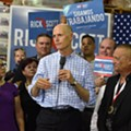 After boos and protests, Rick Scott calls for red tide research center, task force
