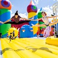 Big Bounce America, the world's biggest bounce house, sets up at Osceola Heritage Park for the weekend