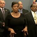 Con woman crashes Tampa press conference, performs phony sign language interpretation