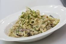 PHOTO BY ROB BARTLETT - House-made spaetzle in white wine cream sauce with mushrooms and frizzled leeks.