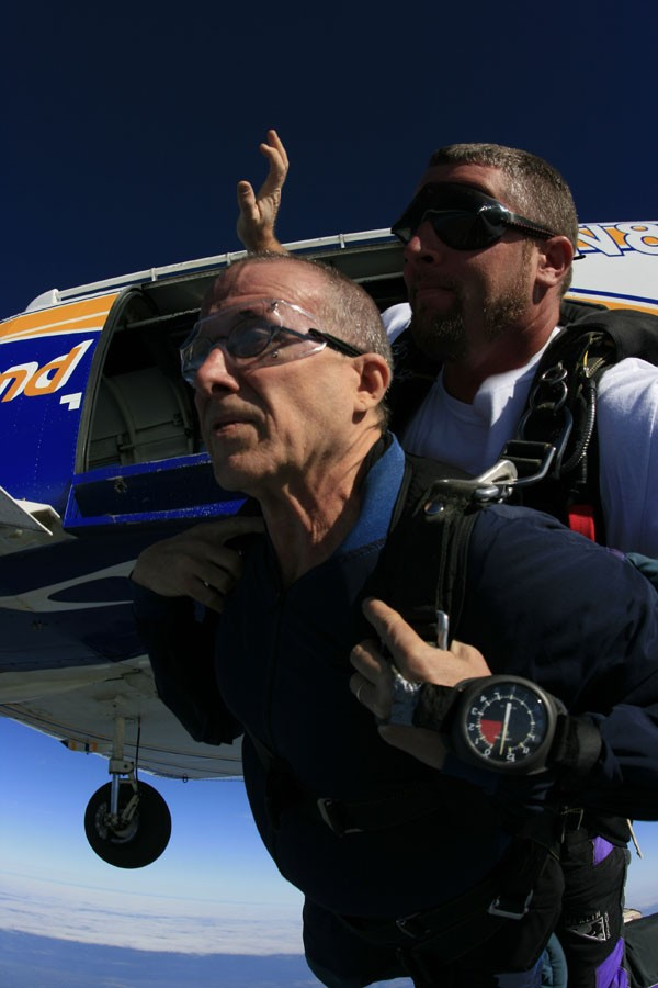 Up in arms: The writer (left) on his virgin jump with instructor Bob Crossman - MICAH COUCH, COURTESY SKYDIVE DELAND