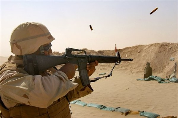 U.S. Navy Petty Officer 2nd Class Jason Maxwell fires an M-16 using a three-round burst at the Joe Foss range during a weapons training in Taqaddum, Iraq, July 27, 2008. The Seabees, assigned to a mobile construction battalion, are on a six-month deployment to Iraq to provide general engineering support to coalition forces. U.S. Navy photo by Petty Officer 2nd Class Dustin Coveny, via defense.gov