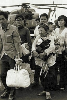 South Vietnamese refugees walk across a U.S. Navy vessel. Operation Frequent Wind, the final operation in Saigon, began April 29, 1975. During a nearly constant barrage of explosions, the Marines loaded American and Vietnamese civilians, who feared for their lives, onto helicopters that brought them to waiting aircraft carriers.