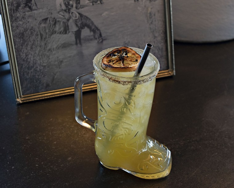 Valentine's Hatch chili margarita is served in a glass cowboy boot. - JACKIE MERCANDETTI PHOTO