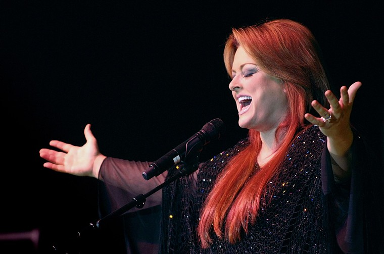Wynonna Judd sings during a performance. - FRED W. BAKER III/WIKIMEDIA COMMONS