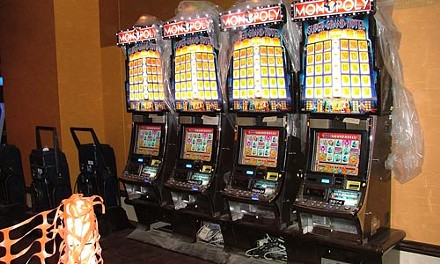 A bank of Monopoly video slots. - CHARLIE DEITCH