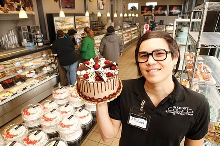 "A cake of one's own: Manager Michael Weaver shows off the bakery's signature cake, the ""Oakmonter."" - PHOTO BY HEATHER MULL"