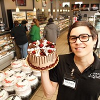 "A cake of one's own: Manager Michael Weaver shows off the bakery's signature cake, the ""Oakmonter."""