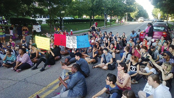 A crowd of about 300 protested racial profiling by law enforcement at a July 20 rally Downtown.