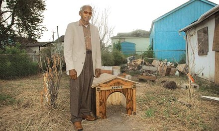 A house but not a home: Malvin, with the doghouse he built for his missing poodle