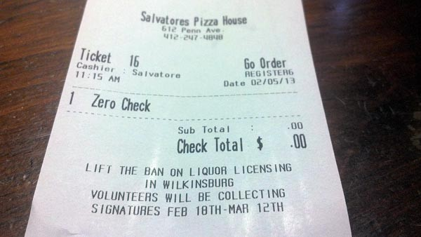 "A receipt at Salvatore's Pizza House urges Wilkinsburg residents to ""lift the ban on liquor licensing."" - PHOTO BY AMYJO BROWN"