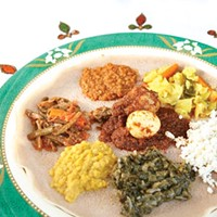 A selection of Ethiopian vegetable and meat entrees, served atop <i>injera</i>