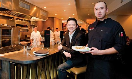 A winning combination: Tamari owner Allen Chen (seated on left) and executive chef Roger Li - RENEE ROSENSTEEL