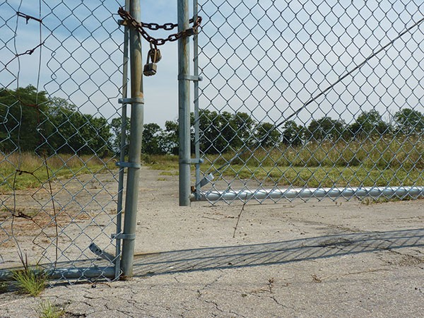 About 82 acres of land in Arlington Heights remains vacant and gated. - PHOTO BY LAUREN DALEY