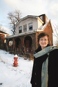 Aggie Brose of the Bloomfield-Garfield Corp. in front of the Kincaid Street property. - HEATHER MULL