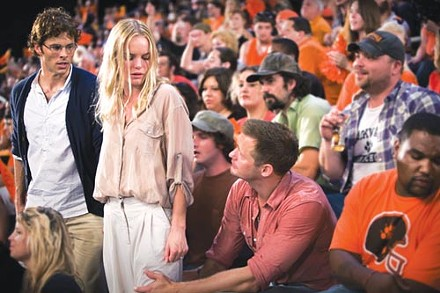 An ugly game: The away team (James Marsden and Kate Bosworth, left) confront the home opposition (Alexander Skarsgrd).