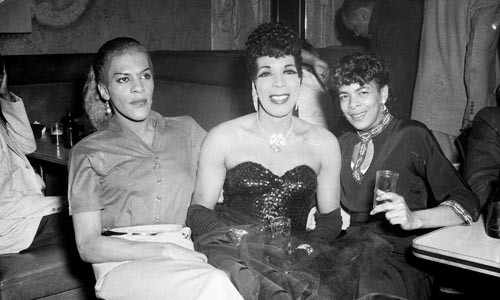 """Another side of the Hill: """"Three cross dressers in a bar, one in full evening dress with sequined bodice"""" (ca. 1959), by Charles """"Teenie"""" Harris"""