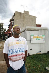 Anthony Ballard sells hot dogs and lemonade from a trailer at the corner of Wylie and Soho in the Hill District. - HEATHER MULL