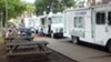 As stationary vendors, food trucks parked along Margaret Morrison Street, near CMU, fall into a different category of regulations than mobile vendors.