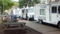 As stationary vendors, food trucks parked along Margaret Morrison Street, near CMU, fall into a different category of regulations than mobile vendors. - PHOTO BY AMYJO BROWN