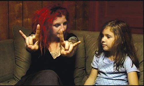 """Assigned language: Danielle McCoy instructs daughter Lydia in """"Metal Mom."""""""