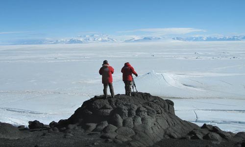 At the top of the bottom of the world: Director Werner Herzog and cinematographer Peter Zeitlinger survey Antarctica.