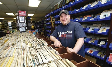 Attic Records' Fred Bohn Jr. and a collection of dry vinyl - HEATHER MULL