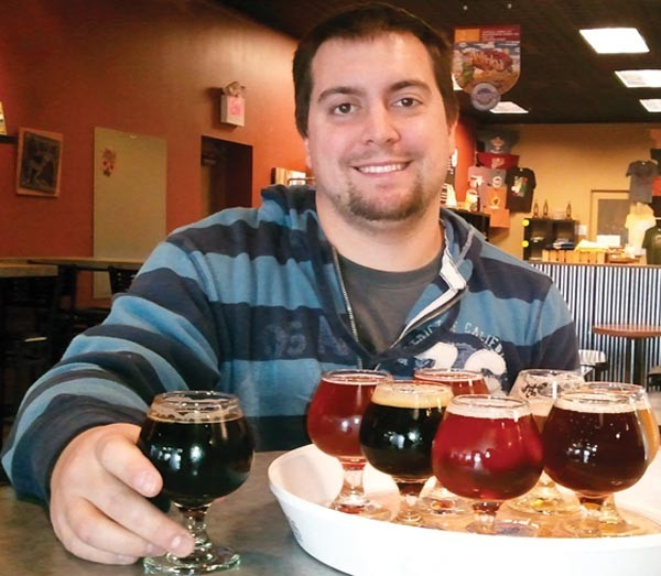 """Bar none: Ryan Slicker, whose """"Poppin Pils"""" will be brewed by Rock Bottom Brewery this year"""