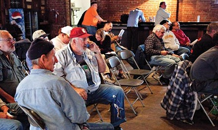 Bidders at an equipment auction on Oct. 23. - BRIAK KALDORF